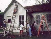 Volunteers working on house
